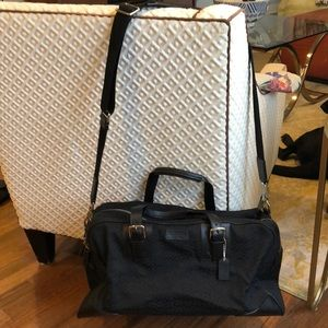 Authentic Coach black weekender bag.